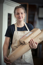 Woman with two packages read for posting