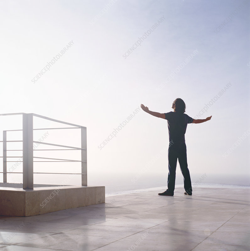 Man standing at edge of the ocean