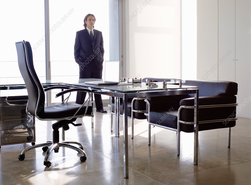 Businessman in a dark suit in an office