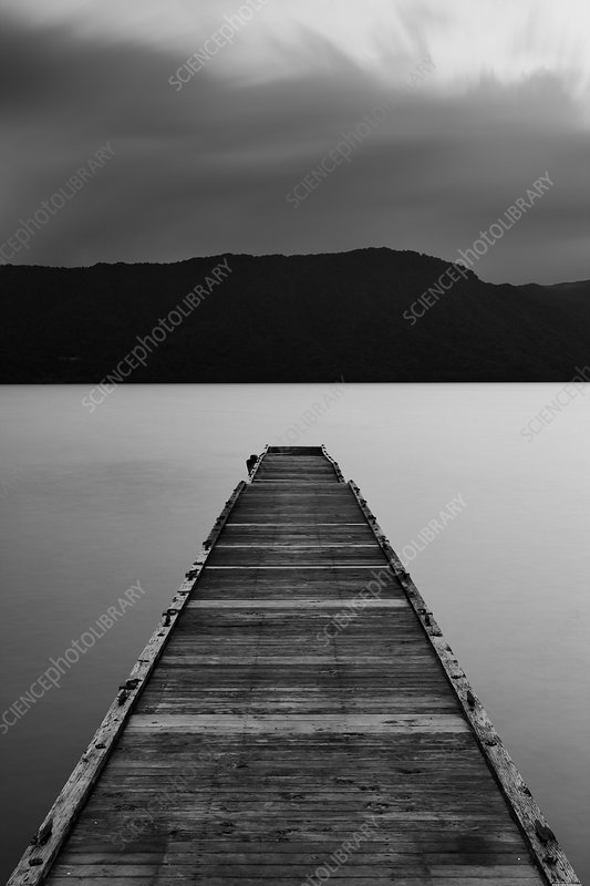 Wooden pier at Towada Lake with mountains