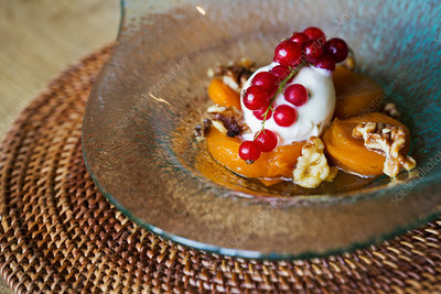 Poached peaches with cream, dessert