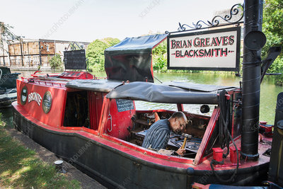 Blacksmith at work on his narrowboat