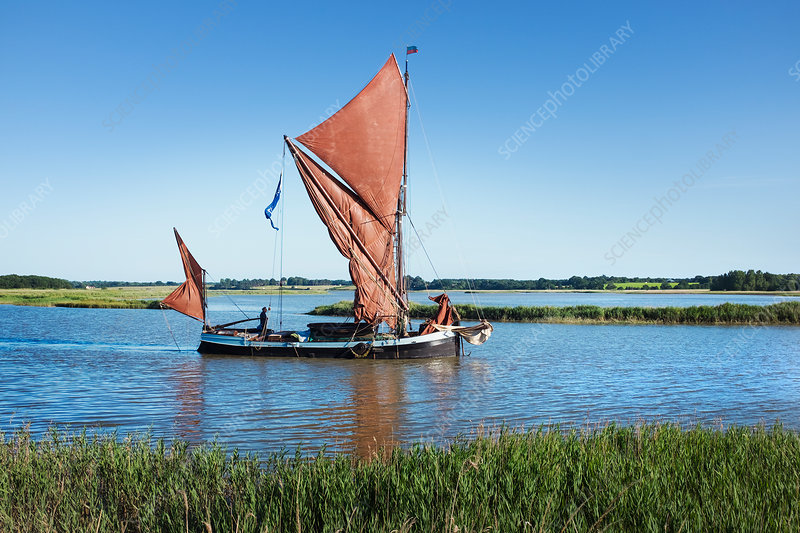 Sailing boat with red sails and gaff rig