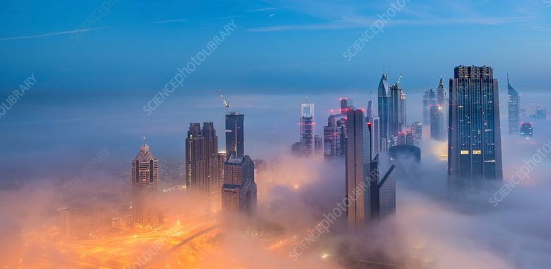 Cityscape above clouds in Dubai at dusk