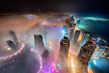 Towers above the clouds in Dubai at dusk