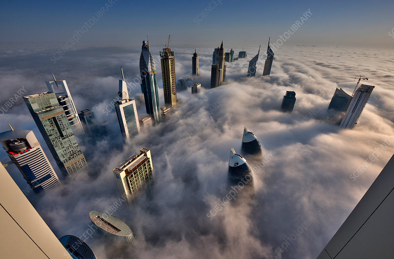 Towers above the clouds in Dubai city