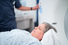 Female patient entering MRI scanner