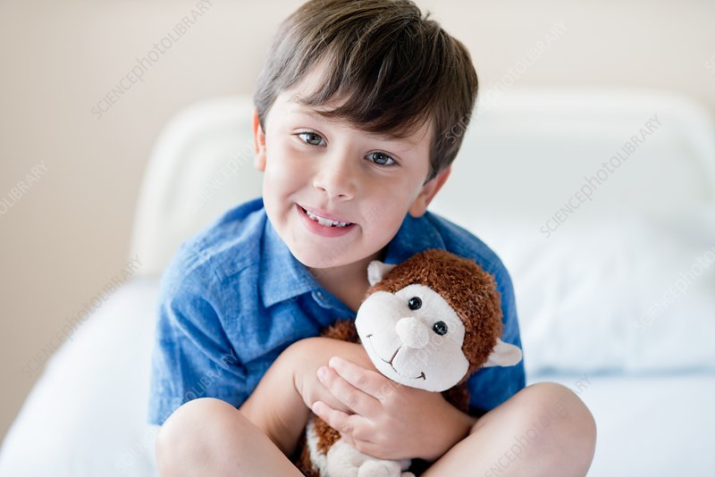 Boy in hospital with teddy bear