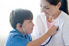 Boy and nurse playing with stethoscope