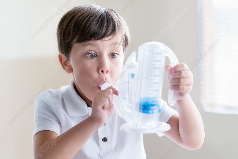 Boy using breathing equipment