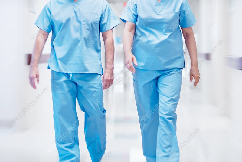 Two doctors wearing surgical scrubs