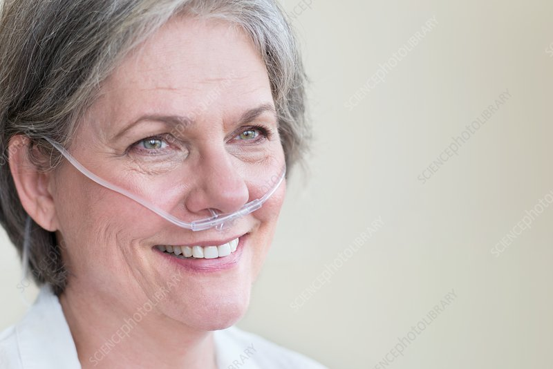 Female patient with nasal cannula