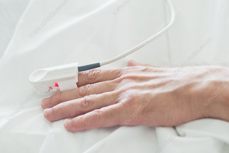 Patient's hand with pulse oximeter