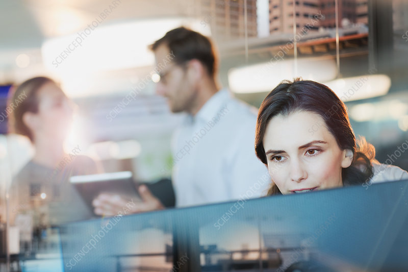 Focused businesswoman working at computer