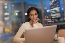 Businesswoman working late at laptop