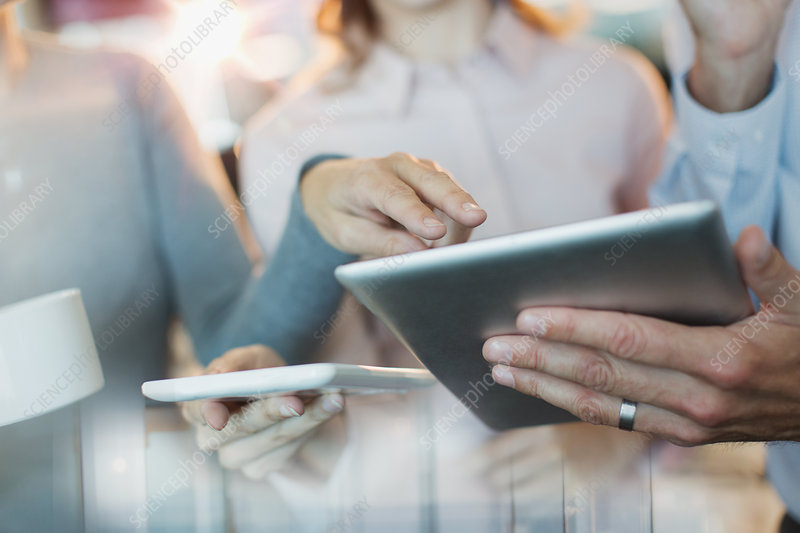Close up business people using digital tablets