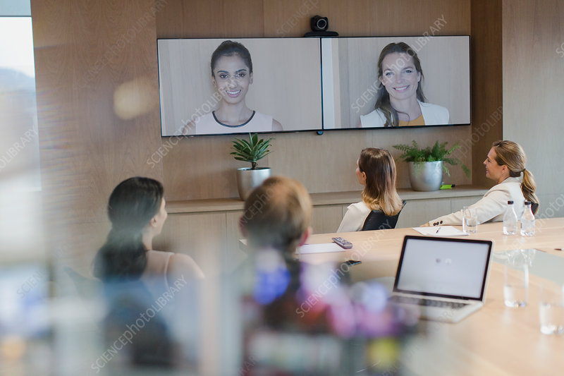 Business people talking on monitors