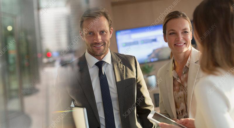 Portrait smiling businessman with businesswomen