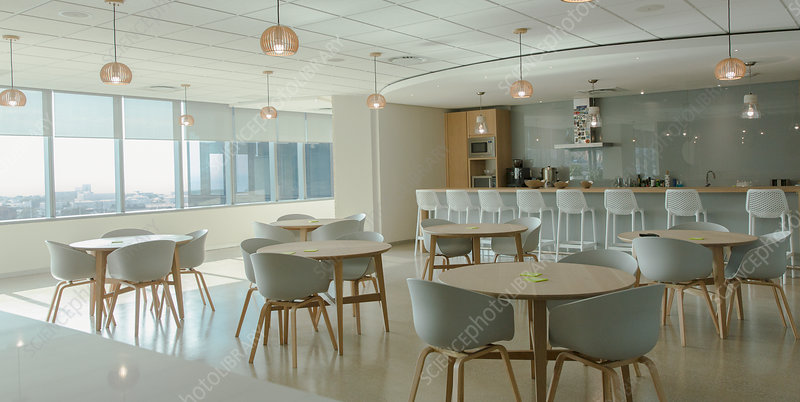 Tables and chairs in modern office cafeteria