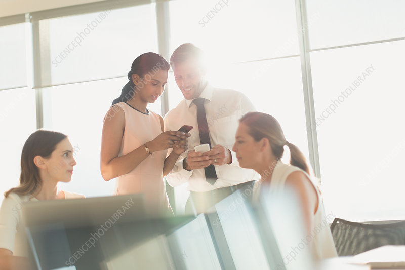 Business people texting with cell phones