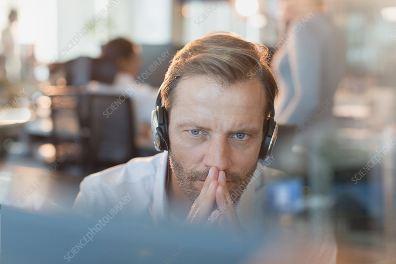Serious businessman wearing headphones