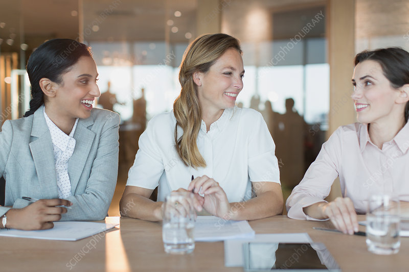 Smiling businesswomen talk