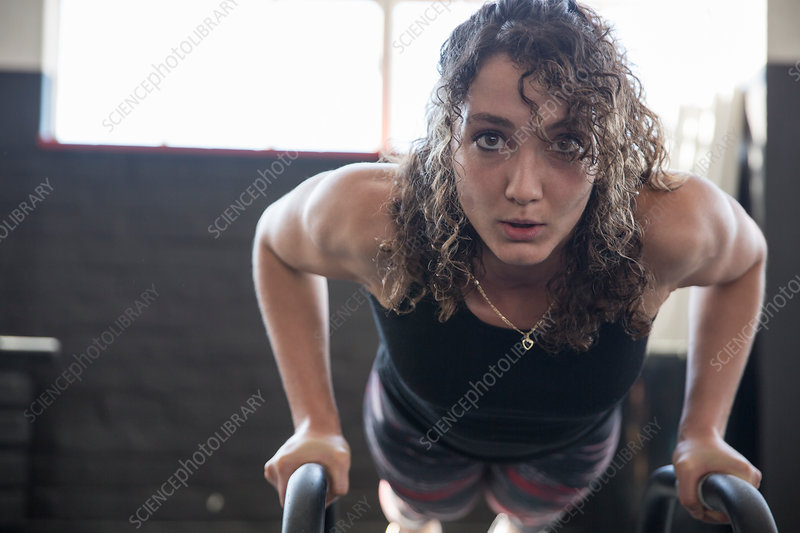 Portrait determined woman doing push-ups