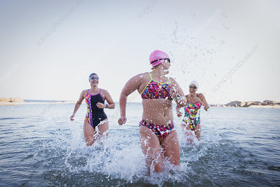 Female swimmers running
