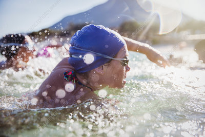 Determined female swimmer swimming