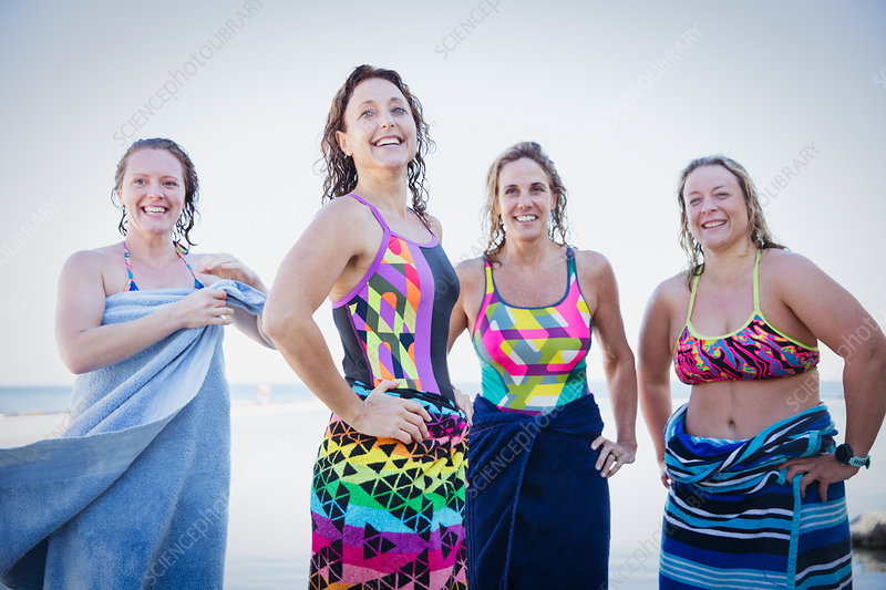 Female swimmers drying off with towels