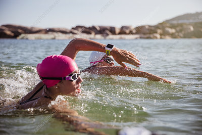 Female swimmer with smart watch swimming