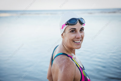 Portrait mature female swimmer at ocean