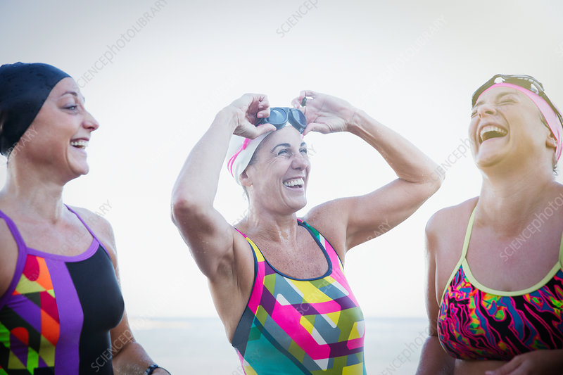 Laughing female swimmers