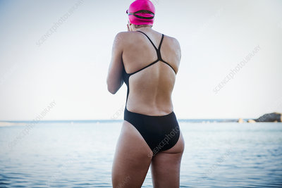 Female swimmer wading