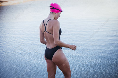 Female swimmer wading in ocean