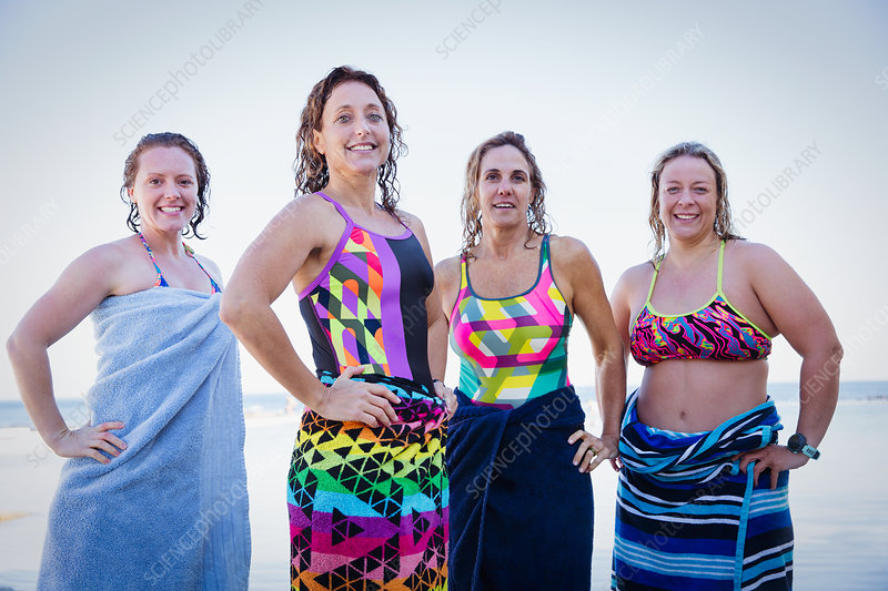 Portrait female swimmers wrapped in towels