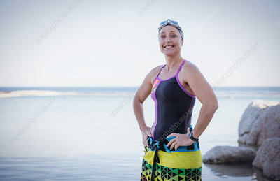 Portrait swimmer wrapped in a towel