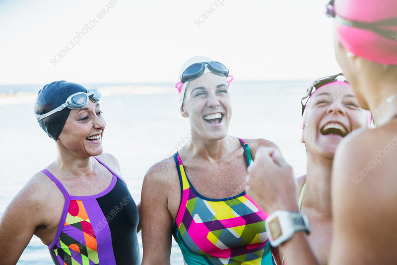 Laughing female swimmers talking