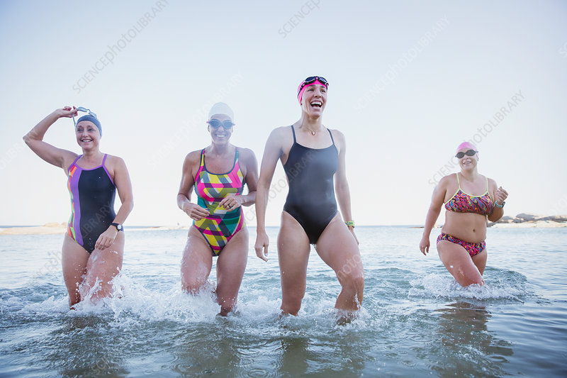 Female swimmers wading in ocean