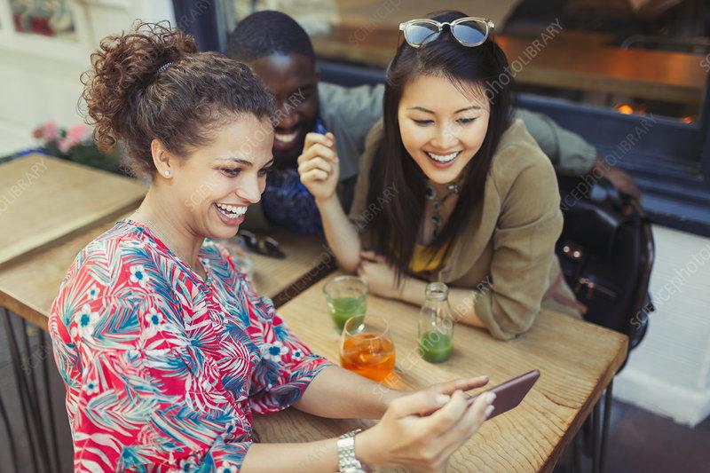 Young women friends using smart phone