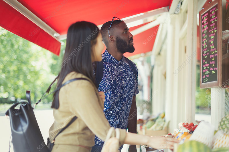 Young couple shopping, looking at prices