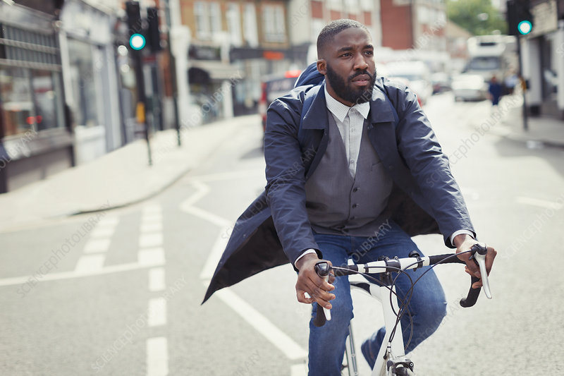 Young male businessman commuting on bicycle
