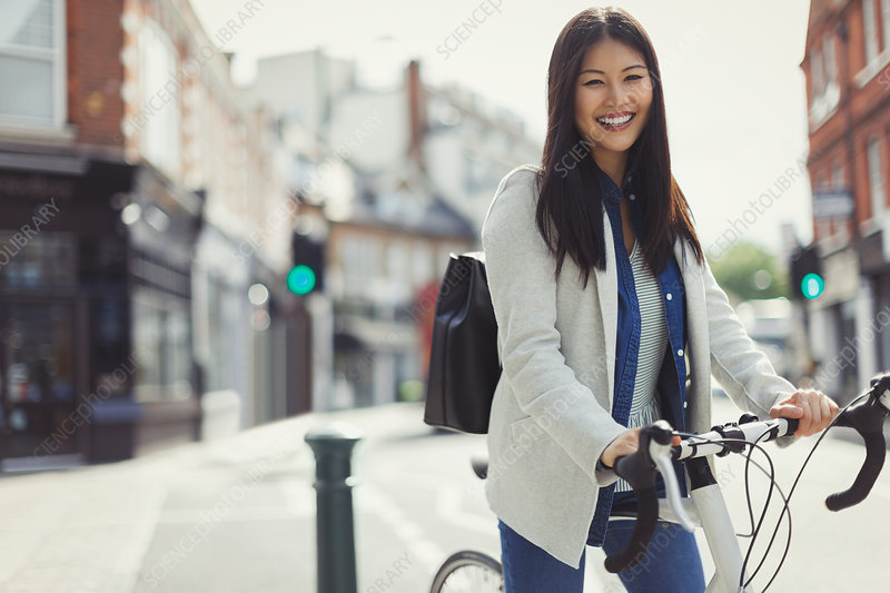 Portrait businesswoman commuting on bicycle