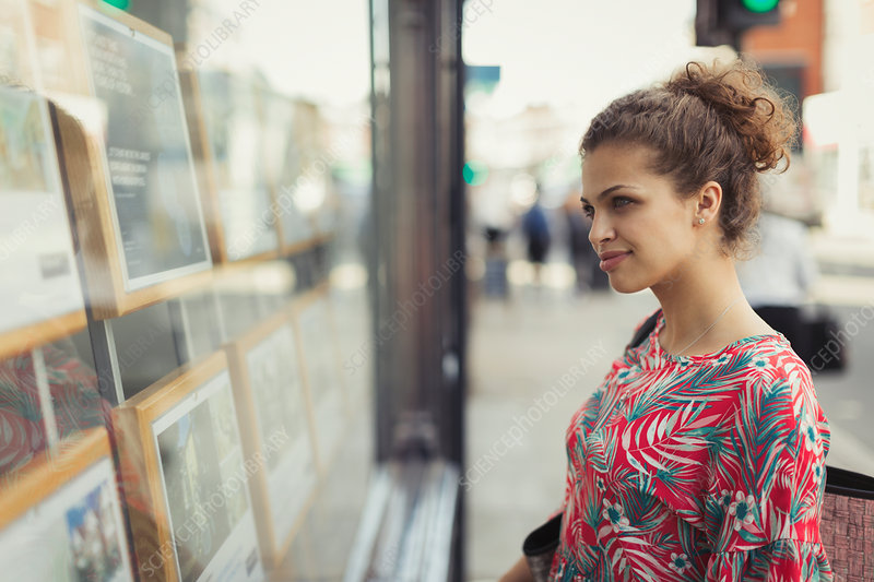 Young woman browsing real estate listings