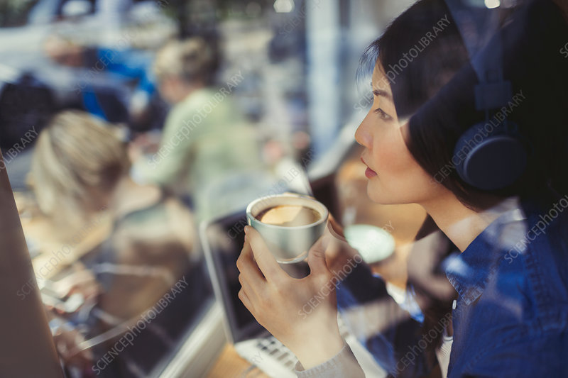 Pensive woman listening to music