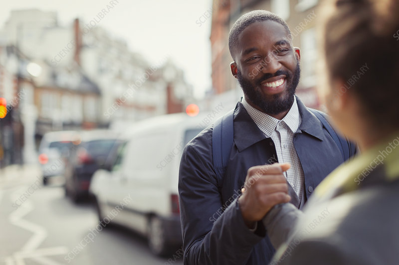 Smiling businessman shaking hands with colleague