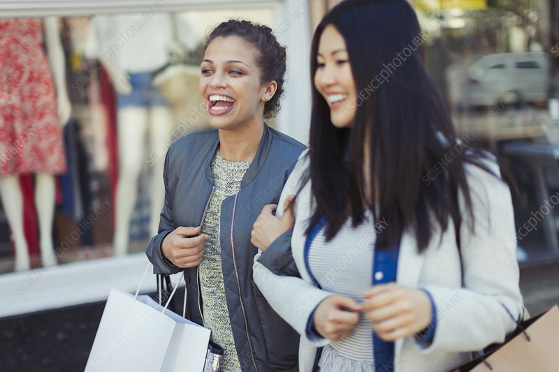 Smiling, happy women with shopping bags