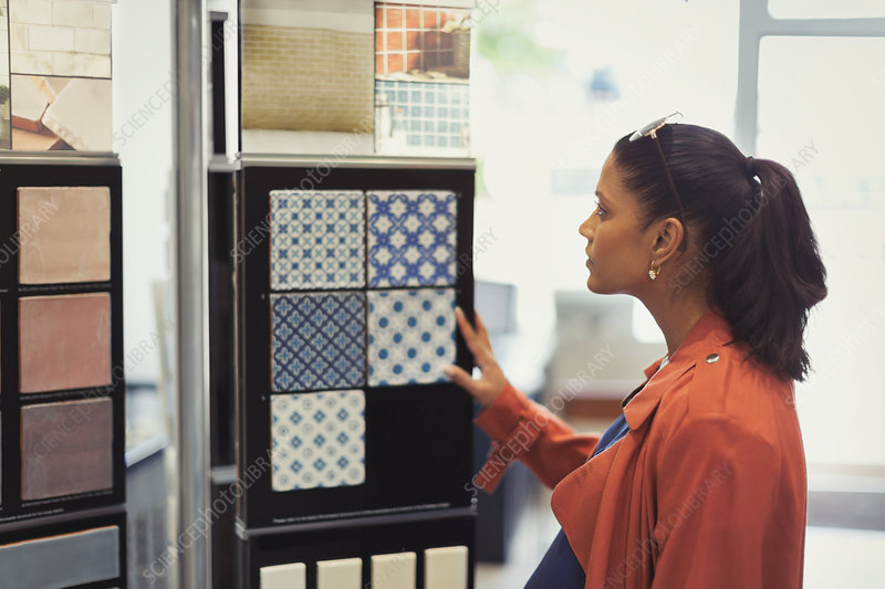 Woman browsing tile samples