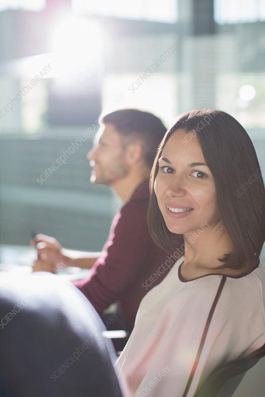 Portrait brunette businesswoman in meeting