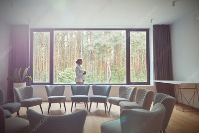 Pensive woman in group therapy room